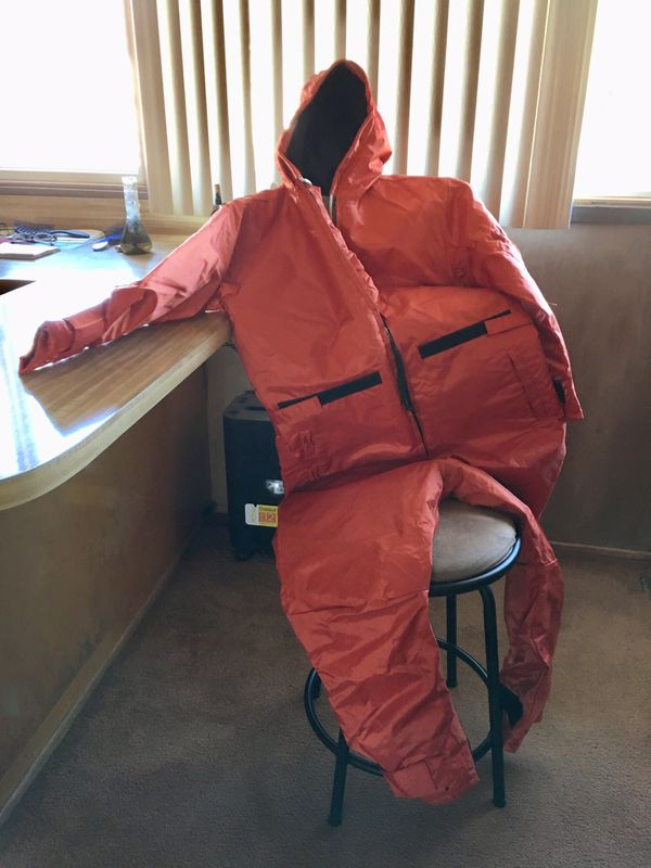 Sub-marine deck coveralls. Will keep you warm in subzero/wet weather. Size men's small. Read the tag. Safety orange color.