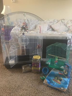 Large birdcage w/travel cage, toys , food, feeders, branch perches and more for Sale in Newburgh, IN