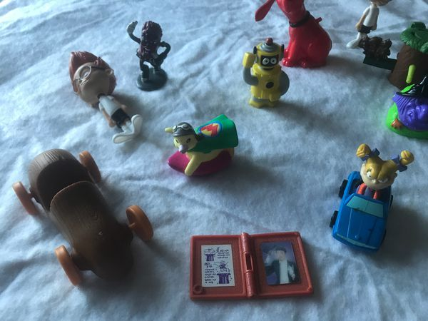 Different Cartoons Tv show figurines Telly tubby Rugrats Disney reason Clifford the rad dog