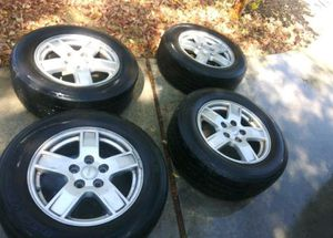 5 lug Rims and tires for a Jeep 17 inch for Sale in Riverside, CA