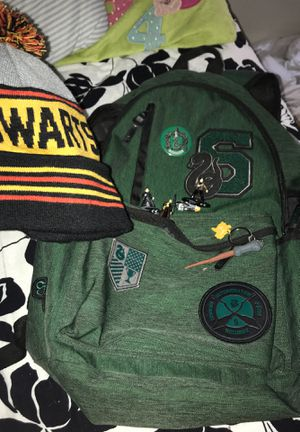 Slytherin Harry Potter back pack from the Harry Potter collectible site retail price 50 with hog warts hat and some Harry Potter toys for Sale in Alexandria, VA