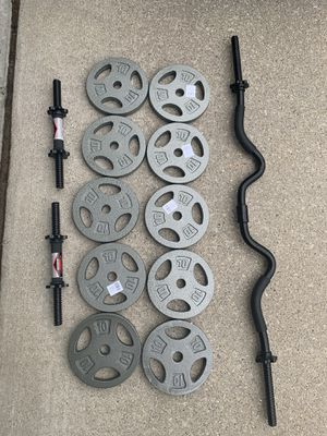 100 LBS ADJUSTABLE PLATES WITH CURL BAR AND DUMBBELL HANDLES for Sale in Warren, MI