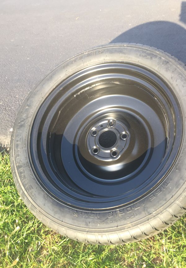 New Chevy 18inch spare tire with kit