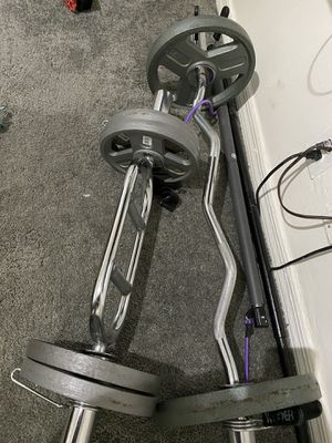 Weider weights 4 10pounds and 2 25 and curve bar for Sale in North Lauderdale, FL
