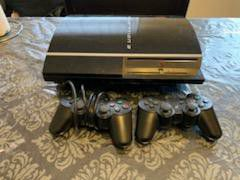 Playstation 3 with 2 remotes & 7 games for Sale in Bridgeport, CT