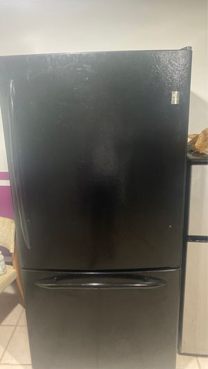 tall refrigerator measures 68 1/8 from front to back 33 and side 31 in good condition for Sale in Philadelphia, PA