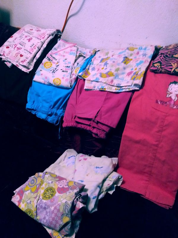 2 sets of Scrubs 4 scrub tops