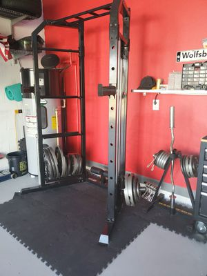 Marcy Cage and Rack with 2 Barbells and Weights for Sale in Davenport, FL
