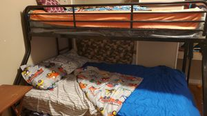 Bunk beds comes with mattress bottom is a full and top (still in cover)is a twin for Sale in Melbourne Village, FL