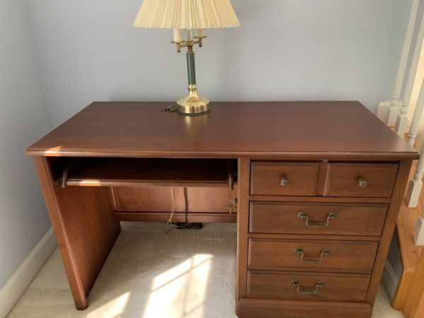 Four piece solid cherry wood desk set in excellent condition. Comes with desk, corner unit and two matching bookcases with filing cabinet.