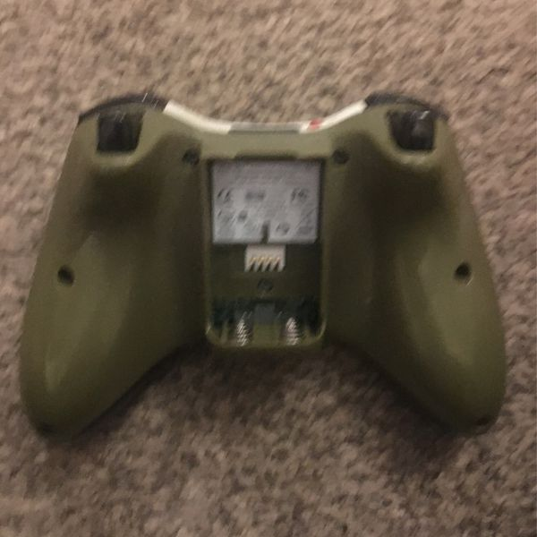 Xbox 360 With Two White Controllers And A Costume Controller