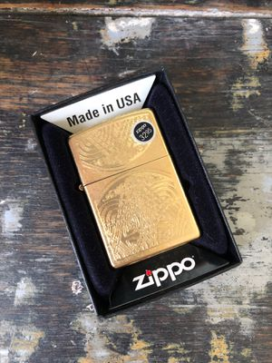 Brand new, never fired zippo lighter Celtic gold finish for Sale in Cleveland, OH