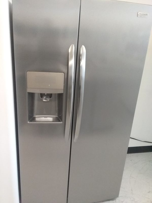 Frigidaire side by side stainless steel refrigerator used good condition 90days warranty