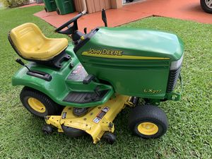 "John Deere LX277 lawn mower / tractor with 48"" cutting deck or consider a trailer trade. for Sale in LAUD LAKES, FL"