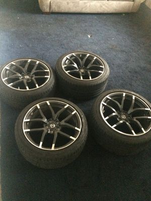 4 Nissan Tires with rims . BLACK for Sale in Colesville, MD