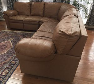Leather sectional sofa with recliner and pull bed for Sale in Ashburn, VA