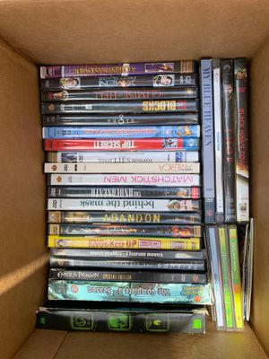 DVD and VHS videos movies plus portable DVD player with car charger and case for Sale in Miami, FL