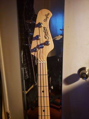 Used Music Man 4 string bass guitar with hard shell case for Sale in San Diego, CA