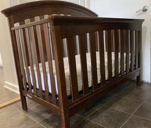 Baby's brown wooden crib for Sale in Arlington, VA