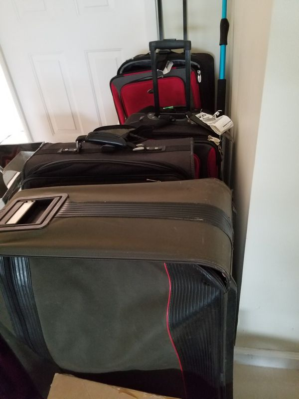 Worn but functional suitcases free. rolling. Clean. Pet free smoke free home