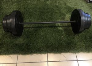 Gym equipment barbell and 100lbs of weight for Sale in Commerce, CA