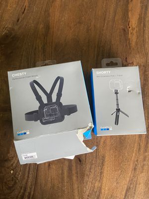 GoPro chest strap and mini tripod extension stick for Sale in Denver, CO