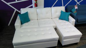 White bonded leather sofa sectional couch with ottoman for Sale in Santa Monica, CA