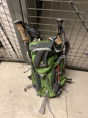 Hiking backpack and poles for Sale in Seattle, WA