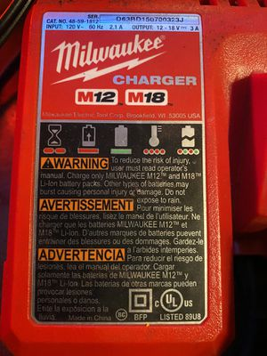 Milwaukee Drill Gun Battery and Charger M18 5.0 for Sale in Norwalk, CA
