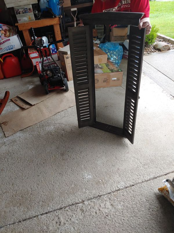 Large mirror with shutter type doors.