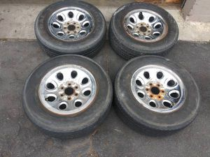 17 inch 6 lug stock chevy or gmc chrome rims with tires for Sale in Montebello, CA