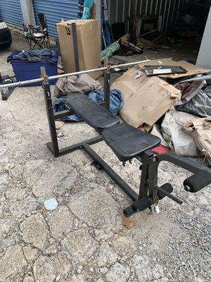 Adjustable weight bench with leg extension/curl and bar included for Sale in Smyrna, GA