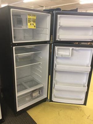 GE brand New Stainless Steel Top Freezer Refrigerator Scraches Dent With Warranty No Credit Needed Just $39 The Down payment Cash price $499 for Sale in Garland, TX