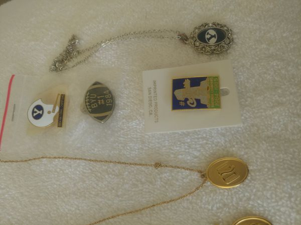 Religious necklaces and BYU pins
