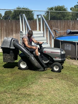 Craftsman riding lawn mower, all bag attachments and trailer for Sale in Bakersfield, CA