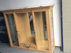 China cabinet with lighting and storage (top & bottom pieces shown separately). Glass shelves not shown. for Sale in Laurel, MD