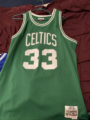 Selling mitchell@ness Larry bird jersey hardwood classic jersey goes for 140 selling for 80 with new era Celtics hat for Sale in Brooklyn, NY
