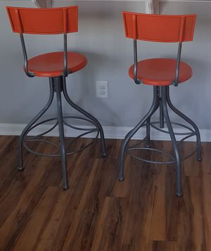 Adjustable orange bar stool moving sale for Sale in Charlotte, NC