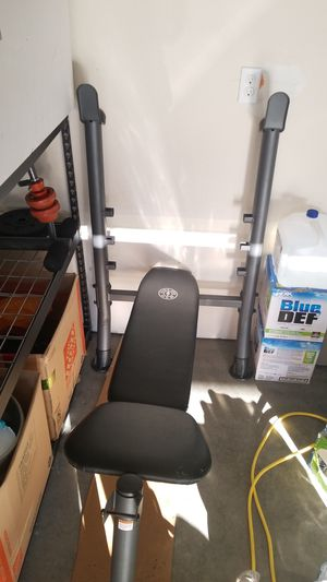 100lbs worth of weight! Included curl bar and dumbbell bars and bunch for Sale in Monroe, WA