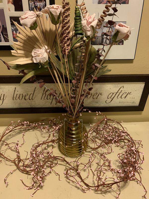 Lamp, vase with dried plants and pink budded vine