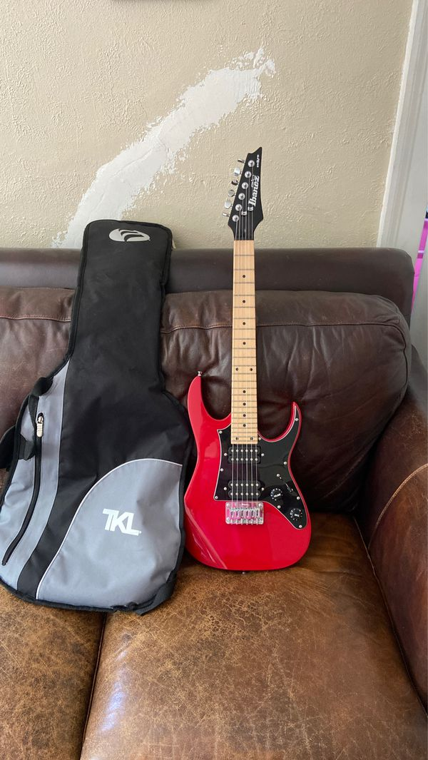 Red and black electric guitar with gig bag( Ibanez) mikro size