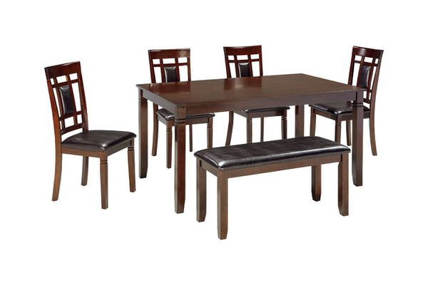 New in box brown color table with 4 chairs and a bench