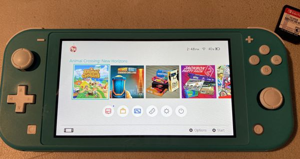 Nintendo Switch Lite Turquoise with case and 3 games