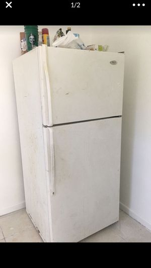Whirlpool Refrigerator Fridge Freezer Works great! Only $100! The whirlpool refrigerator is: 5ft 3 inches high (63 inches high) 2ft 4 inches wide for Sale in Riviera Beach, FL