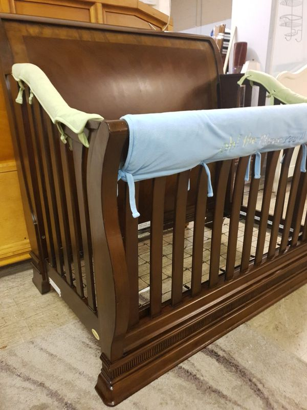 Solid wood baby crib in like new condition