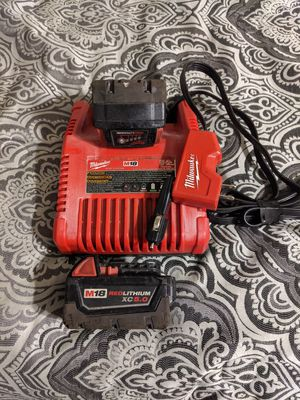 Milwaukee charger and 2 batteries for Sale in Houston, TX