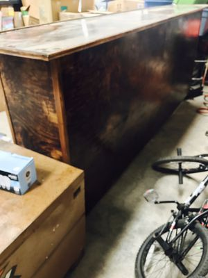 Solid wood bar used as front counter in tattoo shop $875 shelving on rear for Sale in Cohasset, CA