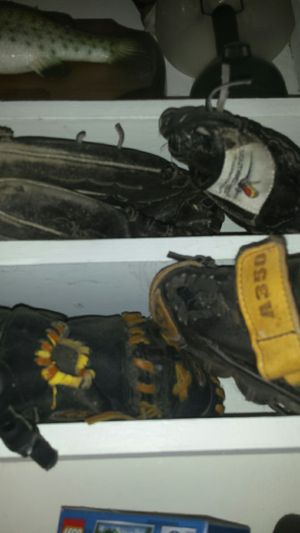 Four baseball gloves for Sale in Tarpon Springs, FL