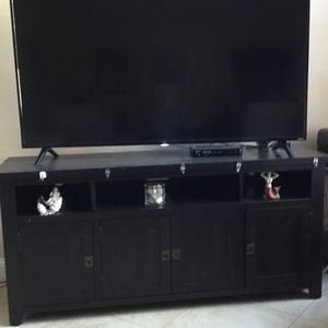 65 Inch Rook Ready Tv Plus Brand New Cabinet With Shelves And Drawers. Tv Only 3 Months Old , Brand Is TLC for Sale in Fort Lauderdale, FL