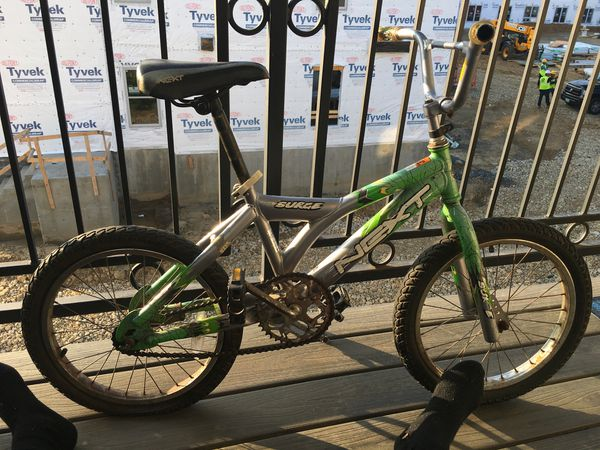 Surge Next Kids trick 🚲 green and grey still very good condition just needs air in rear tire is it brakes work fine everything else is good just back